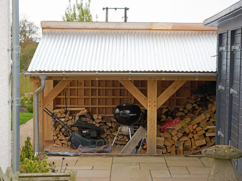 Oak framed woodstore lean-to